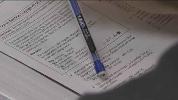 Massachusetts education board approves new hybrid test